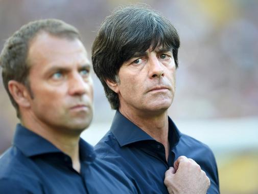 Assistant coach Hansi Flick (L) and head coach Joachim Loew of Germany seen during the FIFA World Cup 2014 quarter final soccer match between France and Germany at Estadio do Maracana in Rio de Janeiro, Brazil, 04 July 2014. Photo: Andreas Gebert/dpa (RESTRICTIONS APPLY: Editorial Use Only, not used in association with any commercial entity - Images must not be used in any form of alert service or push service of any kind including via mobile alert services, downloads to mobile devices or MMS me