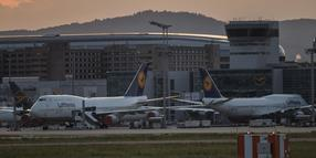 FRANKFURT AM MAIN, GERMANY - MAY 26: Passenger planes of German airline Lufthansa that have been temporarily taken out of service stand parked at Frankfurt Airport during the coronavirus crisis on May 26, 2020 in Frankfurt, Germany. The German government announced yesterday it will intervene with an aid package worth EUR 9 billion to help Lufthansa that will include a 20% stake in the company. The airline has been financially hammered by the collapse in international travel. The deal still needs approval from the European Commission. (Photo by Thomas Lohnes/Getty Images)